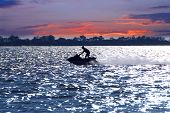 stock photo of waverunner  - Man on jet ski at sunset - JPG