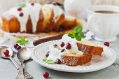 image of icing  - slices of freshly baked cupcakes with icing and fresh cranberries on the holiday table - JPG