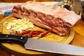 foto of ribs  - Fresh pork ribs meat marinated and prepared for roast with garlic - JPG