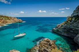 picture of boat  - Dream bay seascape with turquoise transparent water and sailing boat - JPG