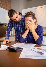 stock photo of cry  - Young guy friend gives solace to desperate unemployed woman crying by her debts - JPG