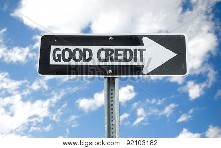 Good Credit direction sign with sky background