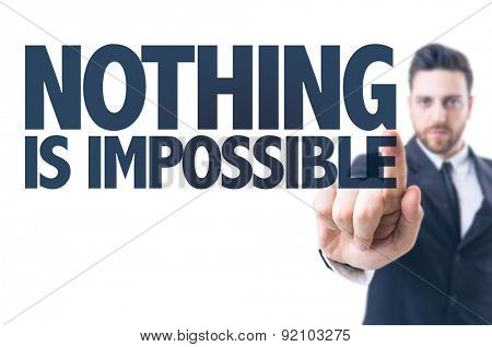 Business man pointing the text: Nothing is Impossible