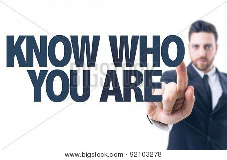 Business man pointing the text: Know Who You Are