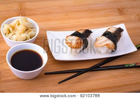 Soy Sauce, Ginger With Two Nigiri Eel On Bamboo Table
