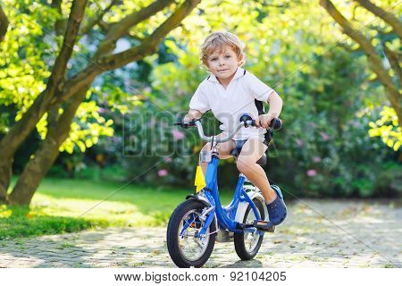 Adorable Child Having Fun With Riding His First Bicycle