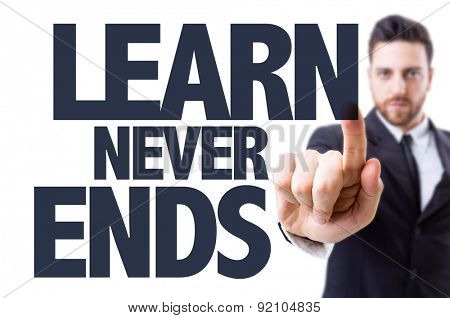 Business man pointing the text: Learn Never Ends