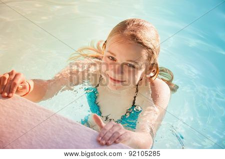 Beautiful Teenage Blond Girl Swims In Pool