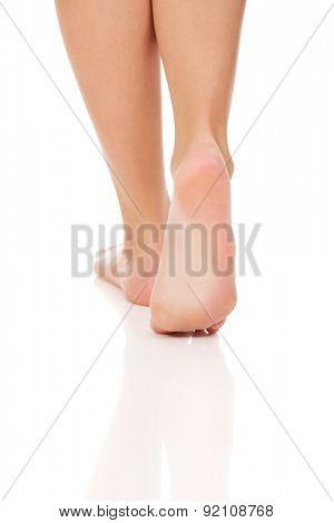 Woman's smooth caucasian bare feet.
