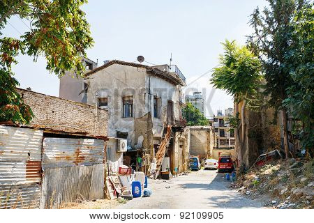 Street with an old townhouse destroyed during the war in the north Nicosia in North Cyprus.