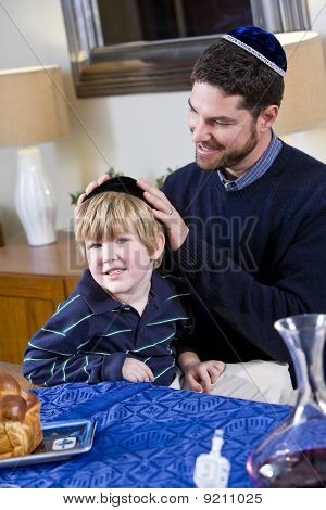 Father And Boy Celebrating Hanukkah