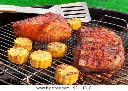 Spatula, Bbq Pork Knuckle And  Spareribs On The Flaming Grill