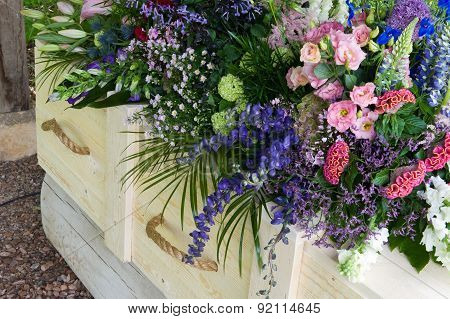 Coffin With Flower Arrangement