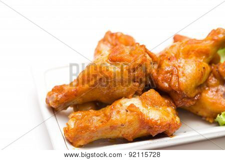 Close-up Grilled Chicken Drumsticks On White Background