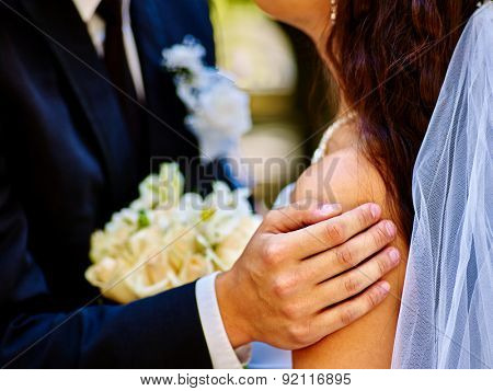 Body part bride and groom holding flower summer  outdoor.