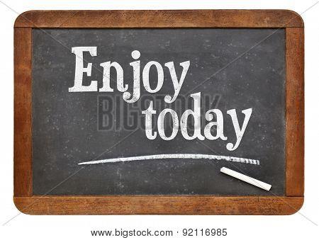 Enjoy today - positive words on a vintage slate blackboard