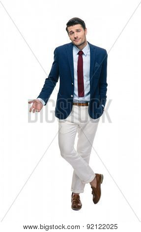 Full length portrait of a handsome businessman shrugging shoulders isolated on a white background
