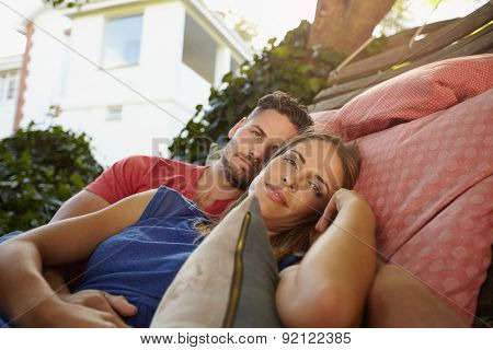 Romantic Couple In Garden Hammock Together