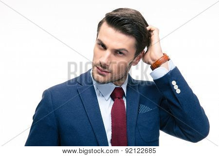 Portrait of a young pensive businessman isolated on a white background. Looking at camera