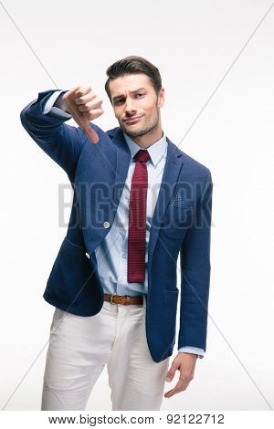 Businessman showing thumb down sign isolated on a white background. Looking at camera