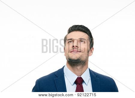 Happy thoughtful businessman looking up at copyspace isolated on a white background