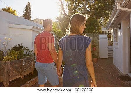 Young Couple Walking Towards Their House