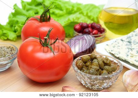 Ripe Tomatoes And Other Foods On A Cutting Board