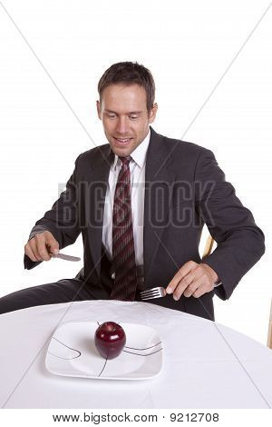 Man Looking At Apple On Plate