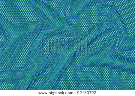 Blue Crumpled Nonwoven Fabric On A Green