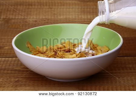 Krispy With Milk In Plate With Spoon