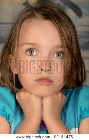 Girl with pensive expression