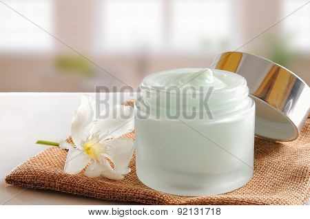 Glass Open Jar With Cream On Burlap