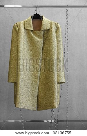 Golden Woman Dress Locked With A Chain In A Wardrobe