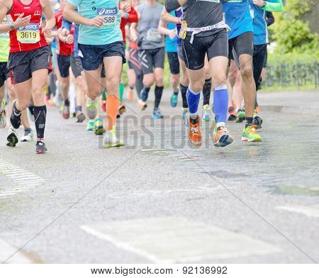 Feet, Legs And Torsos Of A Large Group Of Runner
