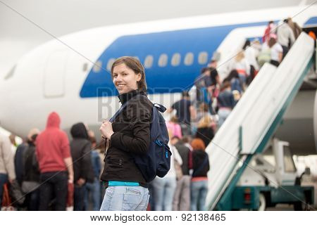 Girl Boarding Airplane