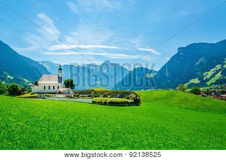 Alpine landscape with typical church Austrian Alps