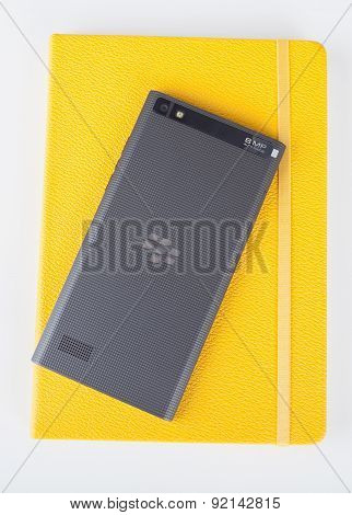 BlackBerry Leap back and yellow notebook