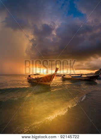 Traditional thai boats at sunset beach. Ao Nang, Krabi province.