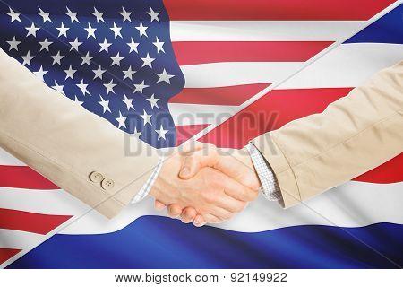 Businessmen Handshake - United States And Costa Rica