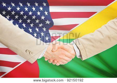 Businessmen Handshake - United States And Guinea-bissau