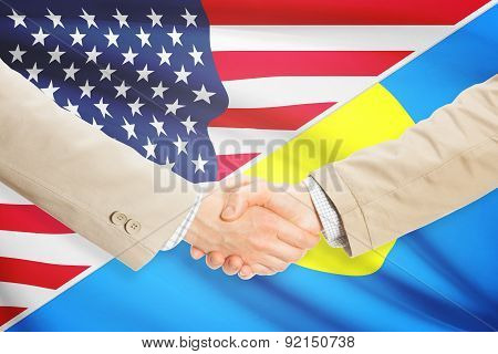 Businessmen Handshake - United States And Palau