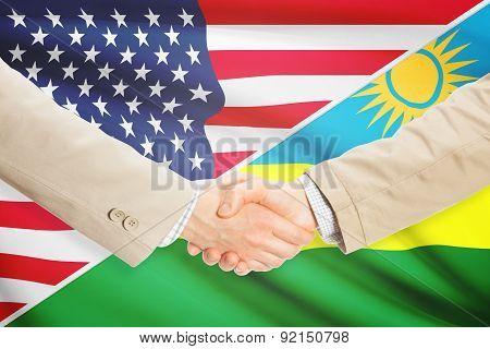 Businessmen Handshake - United States And Rwanda