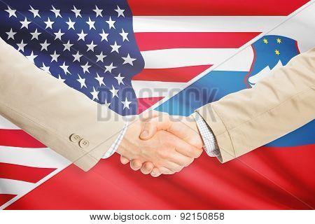 Businessmen Handshake - United States And Slovenia