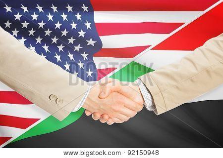 Businessmen Handshake - United States And Sudan