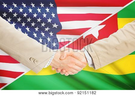 Businessmen Handshake - United States And Togo