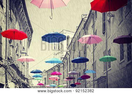 Vintage Filtered Umbrellas Hanging Above Street.