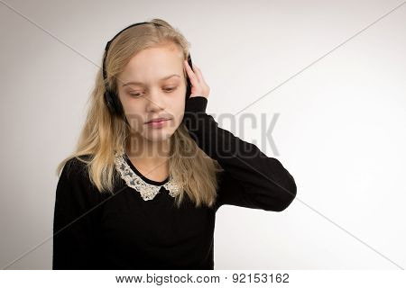 Teenage Blond Girl Listening To Her Headphones