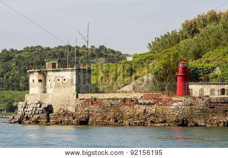 Little lighthouse on a rocky shore