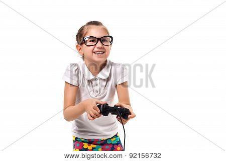 Young Little Girl Play Videogame By Gamepad