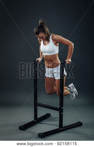 Attractive Young Woman Doing Dip Workout